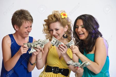 10584448-girls-with-money-in-their-hands-Stock-Photo